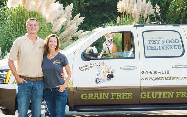 Pet Wants owners in front of their van